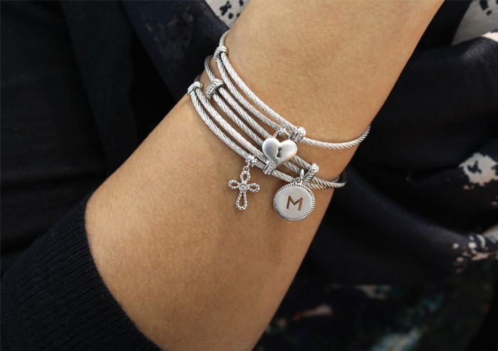 Adjustable Twisted Cable Stainless Steel Bangle with Sterling Silver and White Sapphire Cross Charm angle