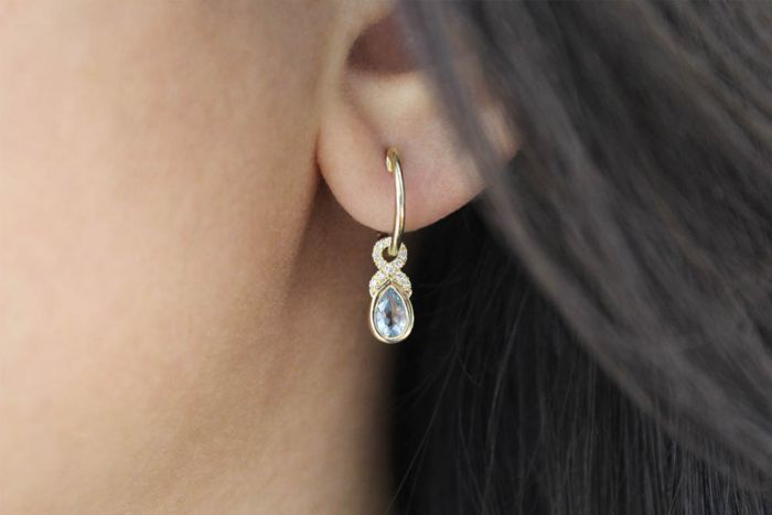 14K Yellow Gold 10mm Diamond and Pear Shaped Aquamarine Huggie Drop Earrings angle