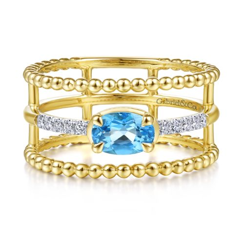14K Yellow Gold Oval Swiss Blue Topaz and Diamond Three Row Ring angle