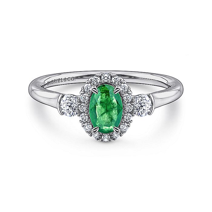 14K White Gold Oval Emerald and Diamond Halo Three Stone Ring