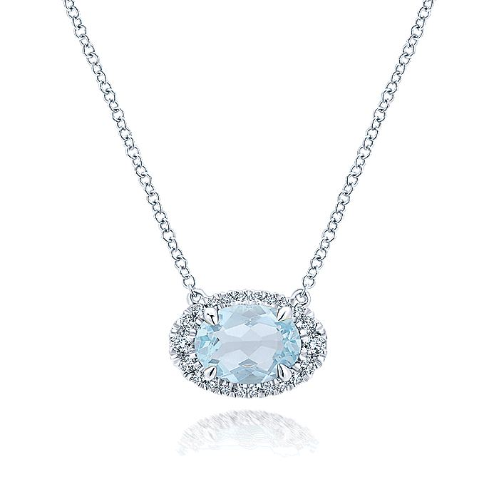 14K White Gold Oval Sky Blue Topaz and Diamond Halo Pendant Necklace