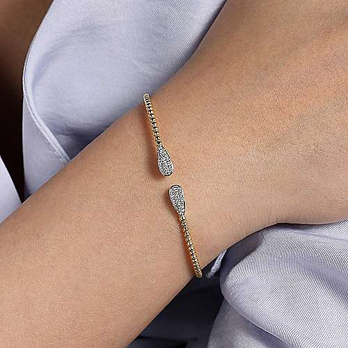 14K Yellow Gold Beaded Bangle with Oval Diamond Accents