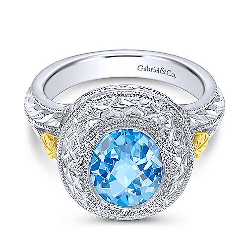 925 Sterling Silver and 18K Yellow Gold Oval Blue Topaz Ring