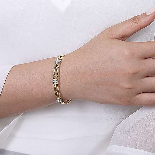 Twisted 14K Yellow Gold Bangle with Three White Gold Diamond Stations