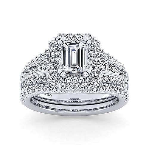Vintage Inspired Platinum Three Stone Halo Emerald Cut Diamond Engagement Ring