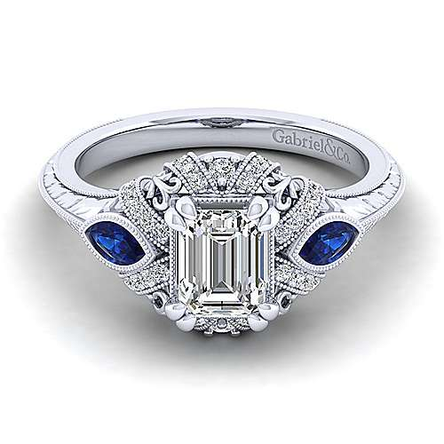 Vintage Platinum Halo Emerald Cut Sapphire and Diamond Engagement Ring